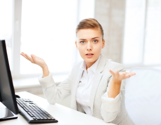 business concept - stressed businesswoman with computer in offic